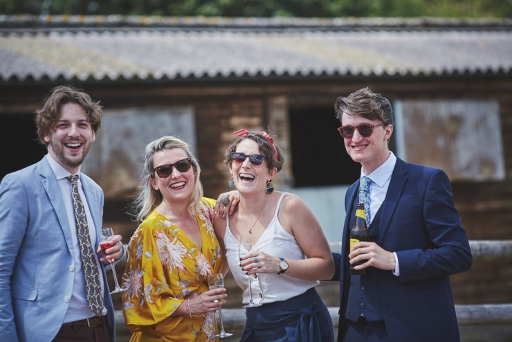 relaxed wedding photography at Upton Barn and walled garden showing guests laughing