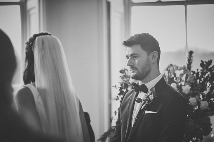 wedding photography of groom looking at his bride to be at small devon wedding