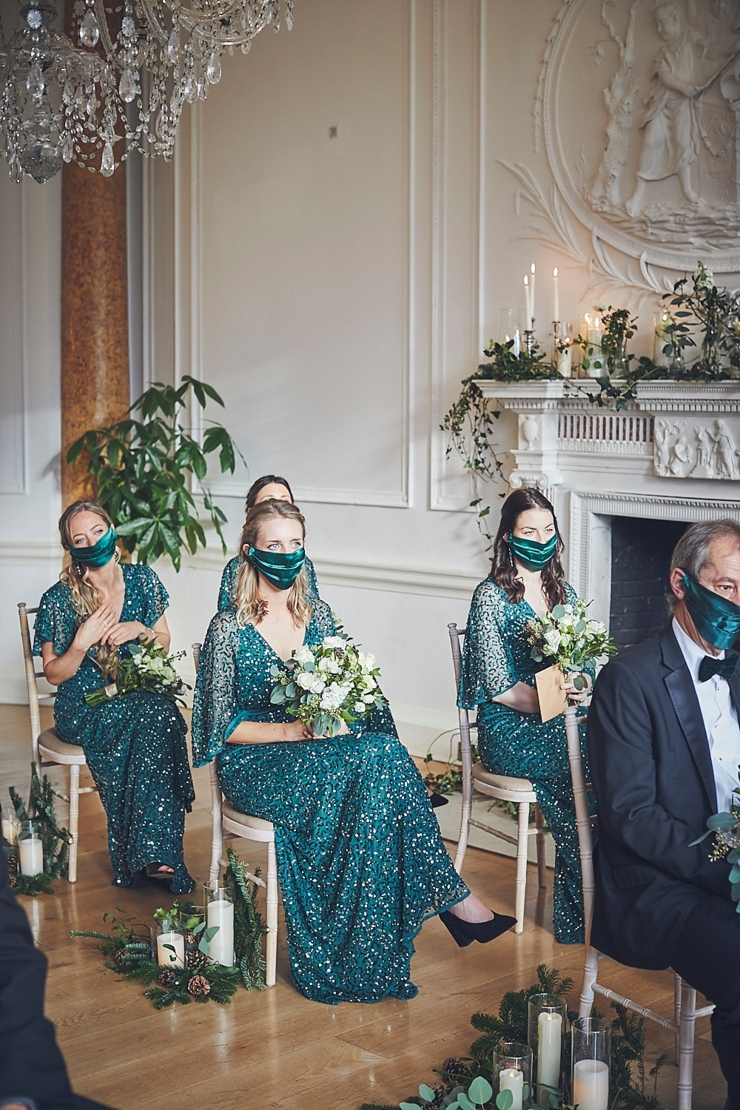 bridesmaids wearing matching green silk cover face masks at small wedding at Rockbeare manor in Devon