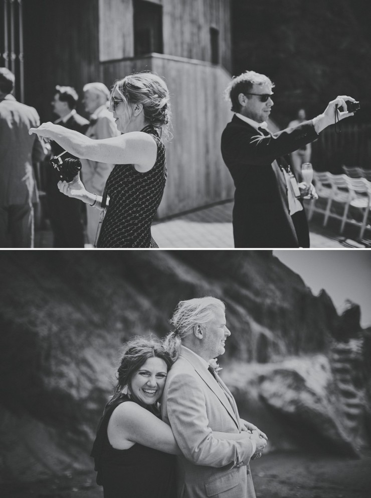 documentary wedding photography of wedding guests taking photos at tunnels beaches in devon