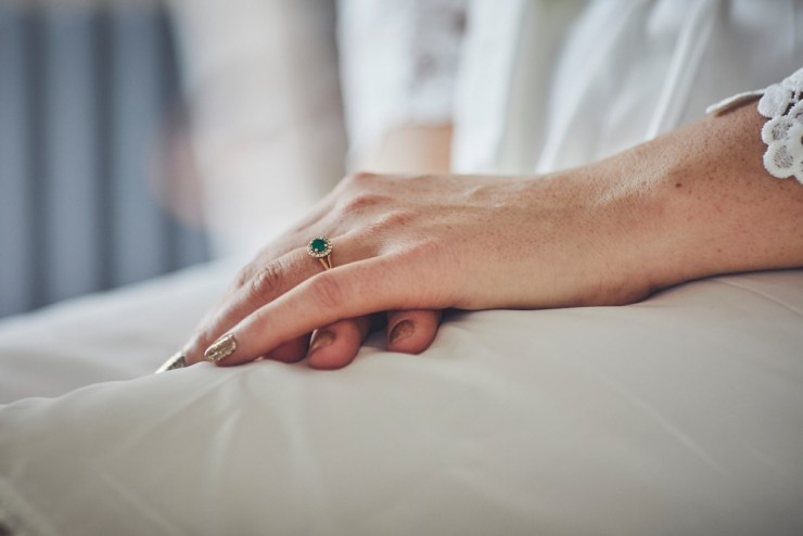 documentary wedding photography of wedding ring from team of two in devon at Rockbeare manor in Exeter