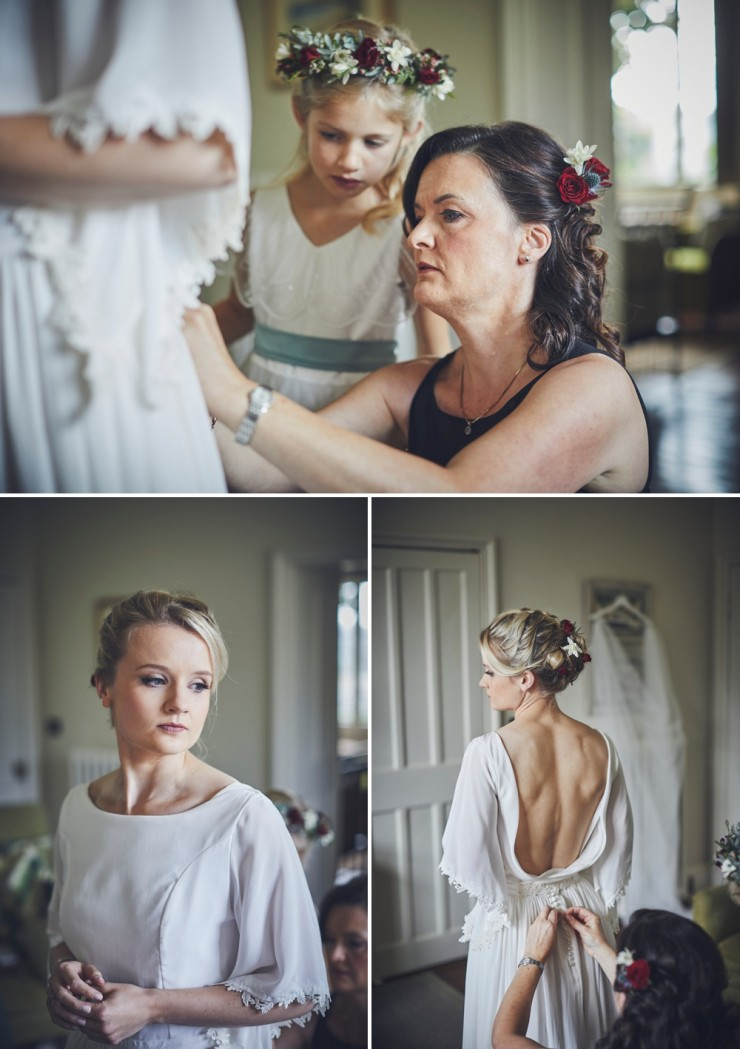 candid photography of mother of bride doing up wedding gown by Aisla Munro during bridal preps at Hotel Endsleigh in Devon