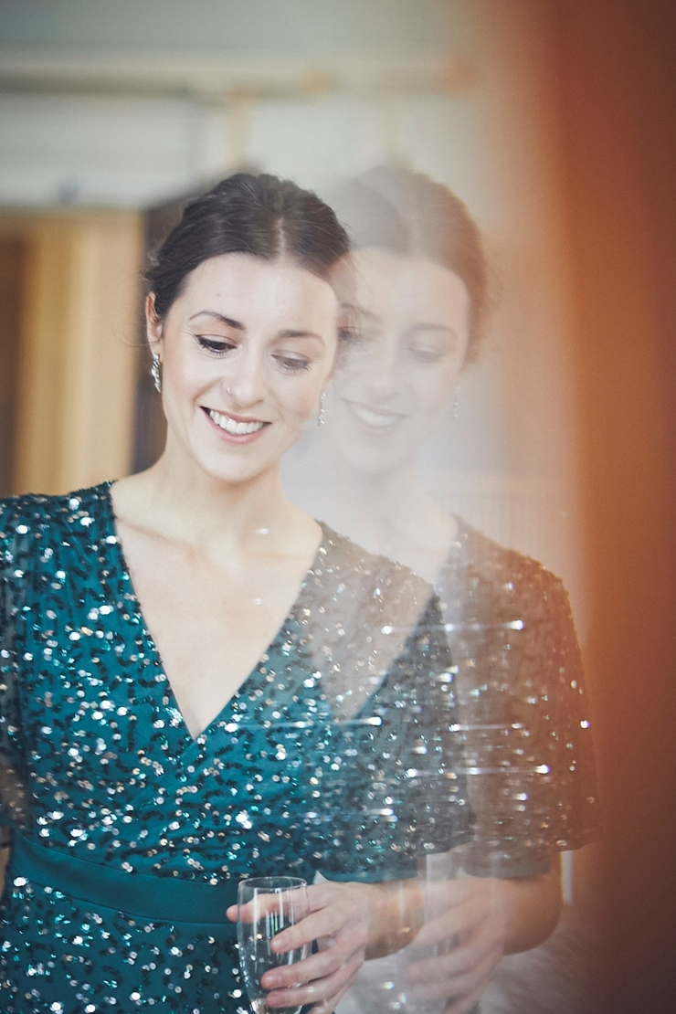 bridesmaid double reflection in vintage mirror at Rockbeare manor mini winter wedding