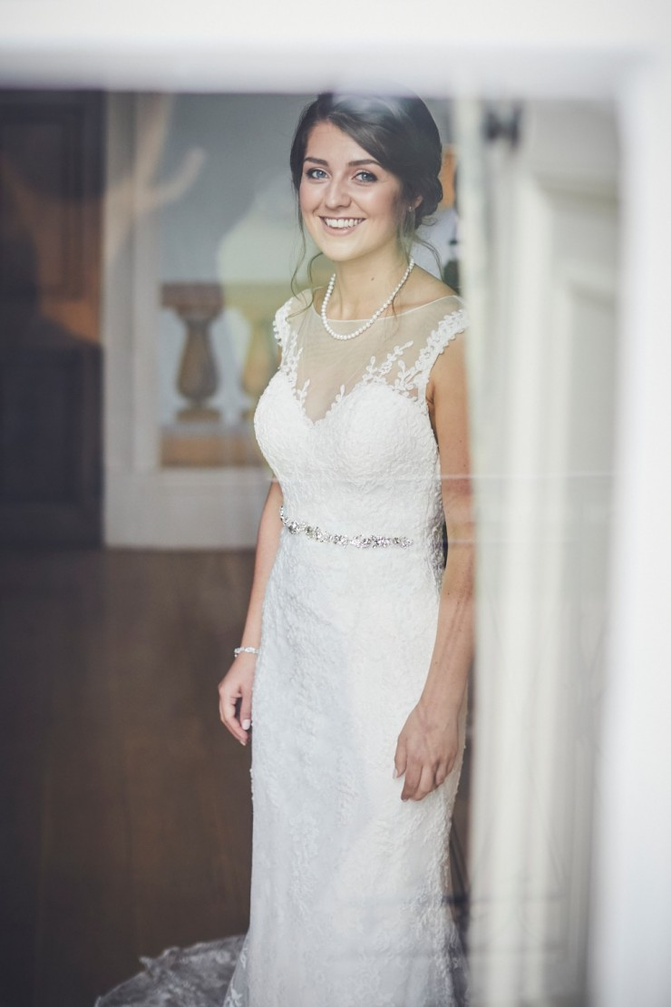 relaxed wedding photography of bride getting ready at a wedding at Rockbeare manor in Exeter devon