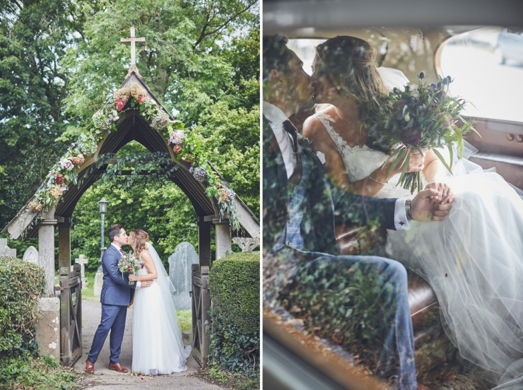 newly married couple kissing under lych gate of Devon church and in back of vintage car