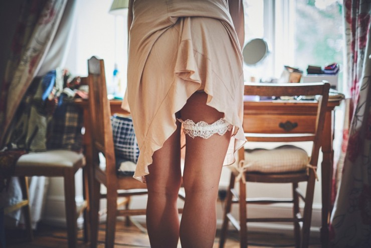 cheeky and fun photo of brides garter