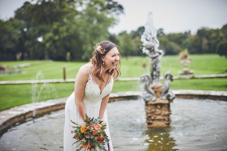 bride laughing at Rockbeare manor in Exeter