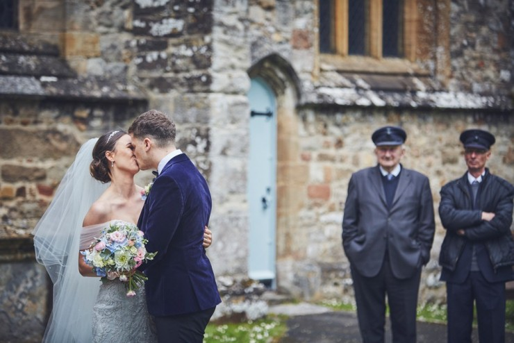 bride and groom kissing, fun photography of a wedding at upton barn devon