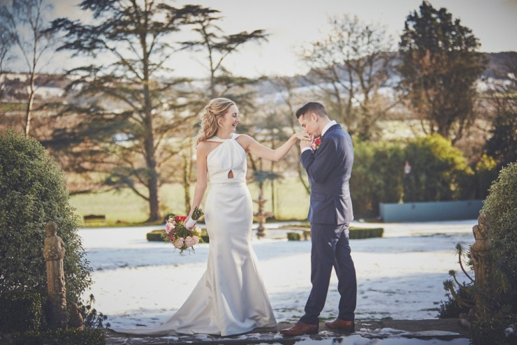 snowy winter wedding photography of bride and groom at wedding at deer park country house hotel in devon