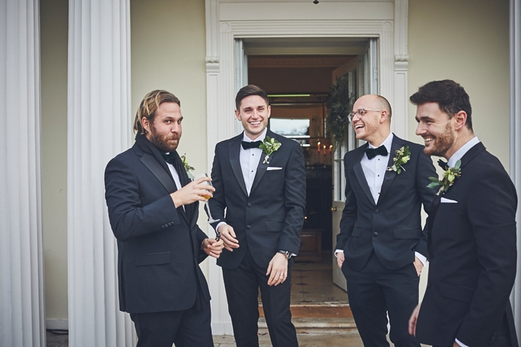 relaxed wedding photography of groomsmen at mini black tie wedding in Devon