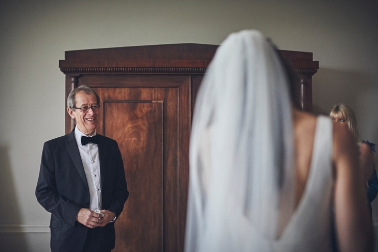 Dad smiling at his daughter before the ceremony at a micro wedding at rockbeare manor devon