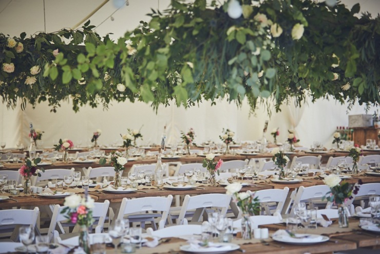hanging roses and wedding styling in marquee in Devon