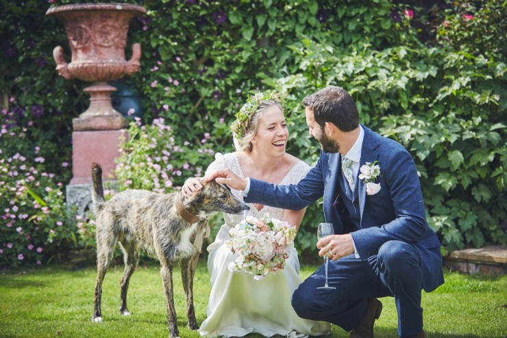 relaxed photography of a marquee country wedding in Devon with couple and their whippet dog