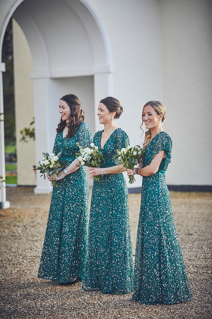 bridesmaids in green sequinned long dresses at small winter wedding at Rockbeare manor in Devon