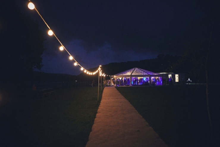 night shot of party at marquee wedding in Devon