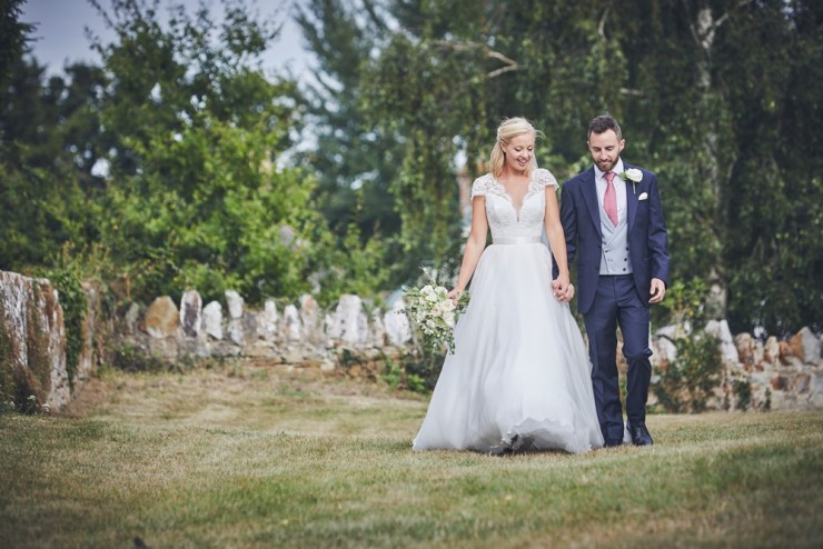 bride and groom walking happily at Somerset wedding