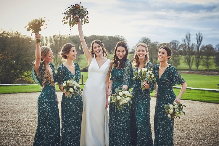 bride and bridesmaids at golden hour at small winter wedding at Rockbeare manor in Devon