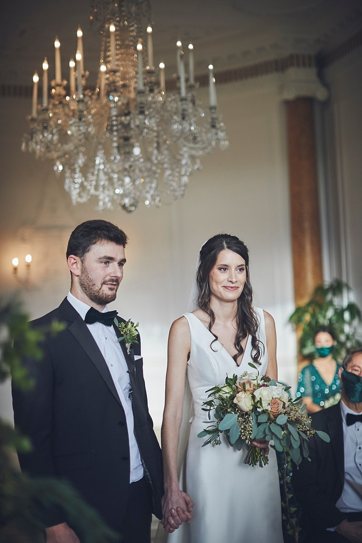 wedding photography of bride and groom smiling at small wedding at Rockbeare manor in Devon