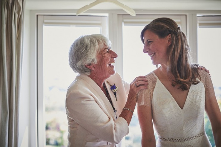 mum and daughter look at each other smiling at South Hams wedding preps