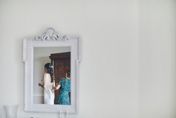 bride and maid of honour in mirror at a mini wedding at Rockbeare manor Devon