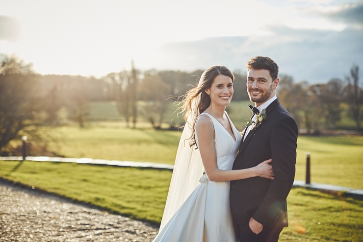 bride and groom in golden hour sunlight at small winter wedding at Rockbeare manor in Devon