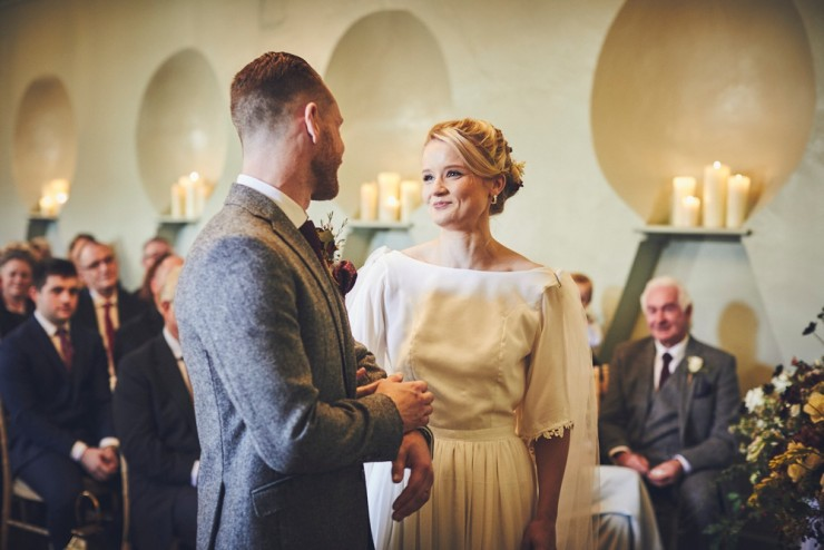 relaxed wedding photography of an Autumn wedding ceremony in the barn at Hotel Endsleigh in Devon