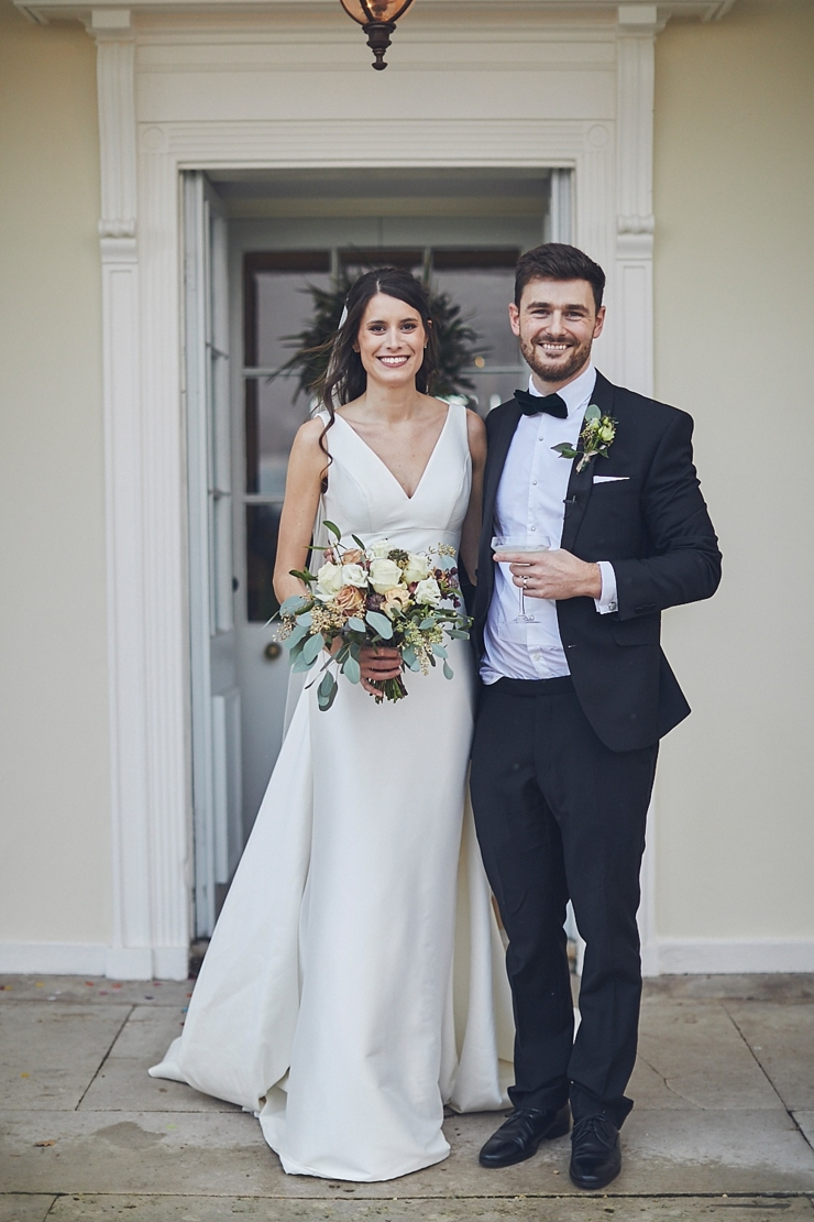 relaxed wedding photography of bride and groom at mini black tie wedding in Devon