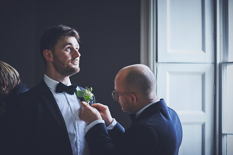 groom getting ready at intimate wedding at Rockbeare manor in Devon