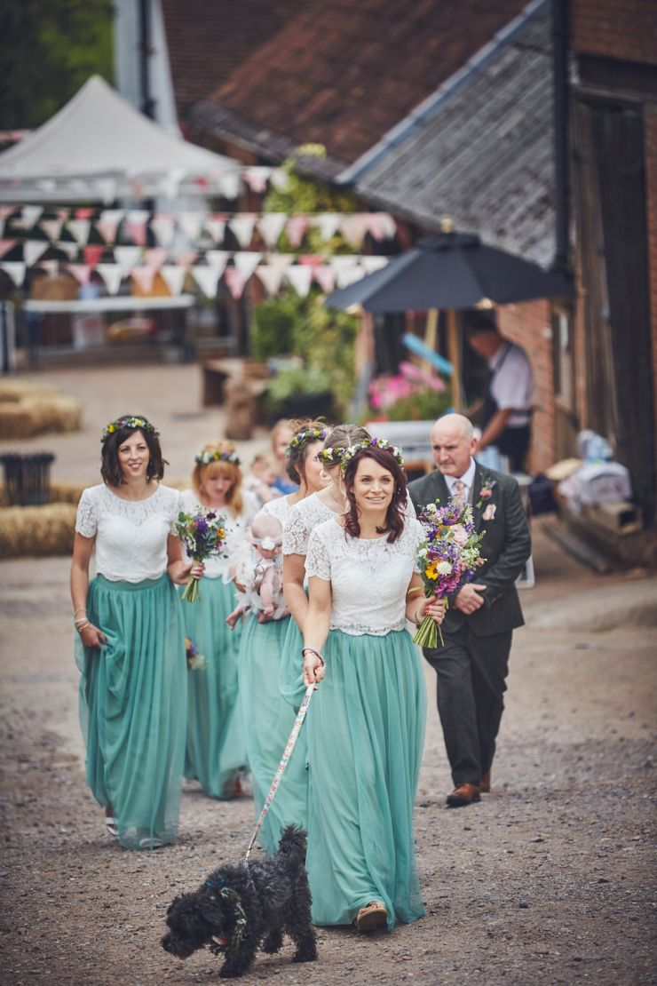 bride and bridesmaids walking to ceremony at West Town Farm in Devon