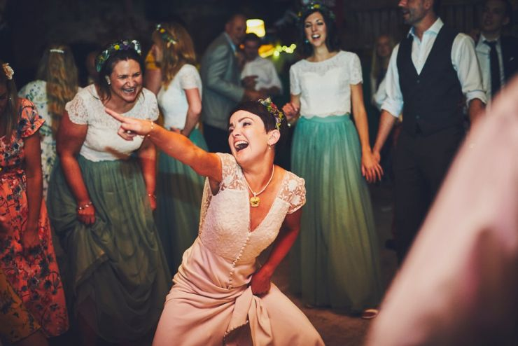 bride dancing at Devon wedding venue West Town Farm