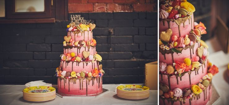 colourful cake covered in chocolates and macaroons at West Town Farm barn wedding