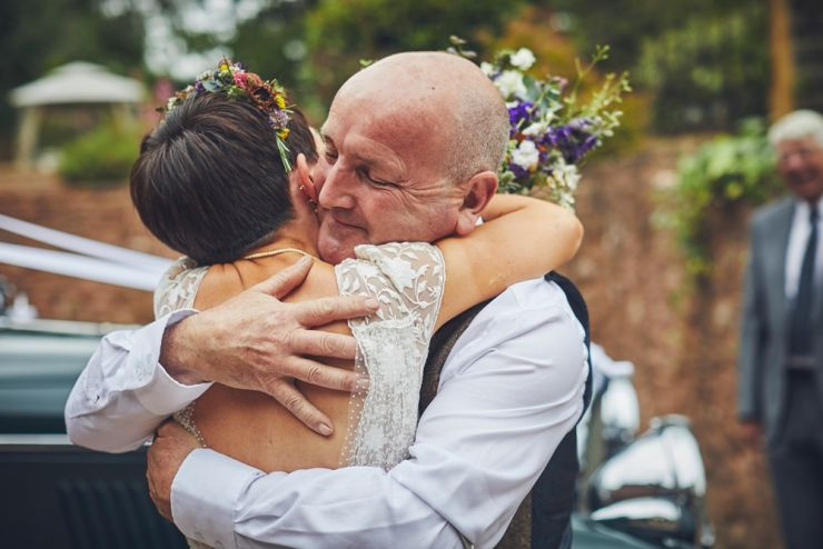 father and daughter embrace before her wedding