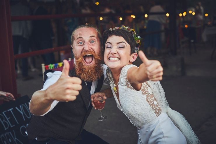 bride and guest doing thumbs up happy at West Town Farm in devon