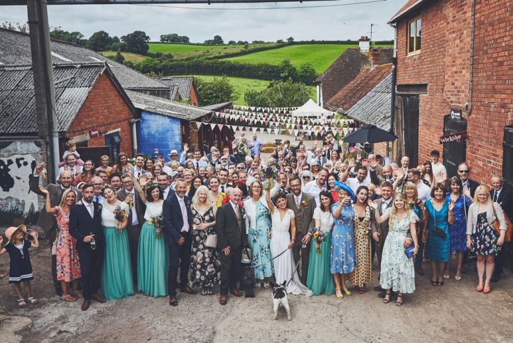 photography of all the guests smiling at camera at Devon wedding at West Town Farm devon