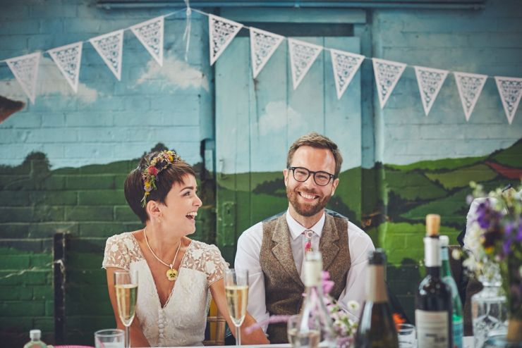 reportage wedding photography of bride and groom's reaction to speeches at a wedding at a West Town Farm devon