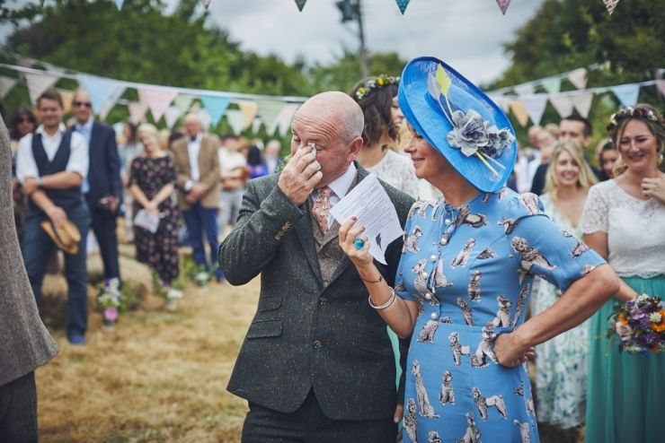 mum and dad emotional at hand tying humanist wedding ceremony at West Town Farm in Exeter