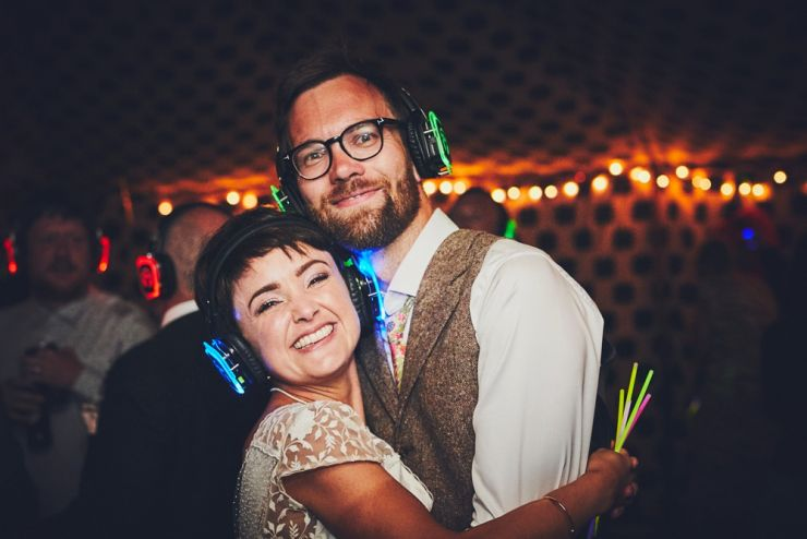 bride and groom's smiling at camera at silent disco at West Town Farm