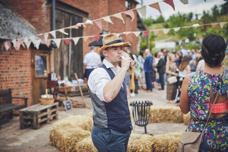 documentary wedding photograph of relaxed wedding guest at West Town Farm in Devon