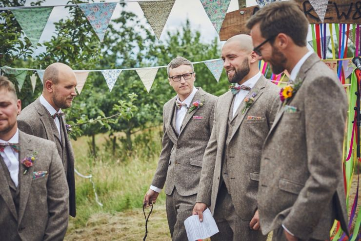 photography of the best men and ushers before the hand tying ceremony at West Town Farm barn