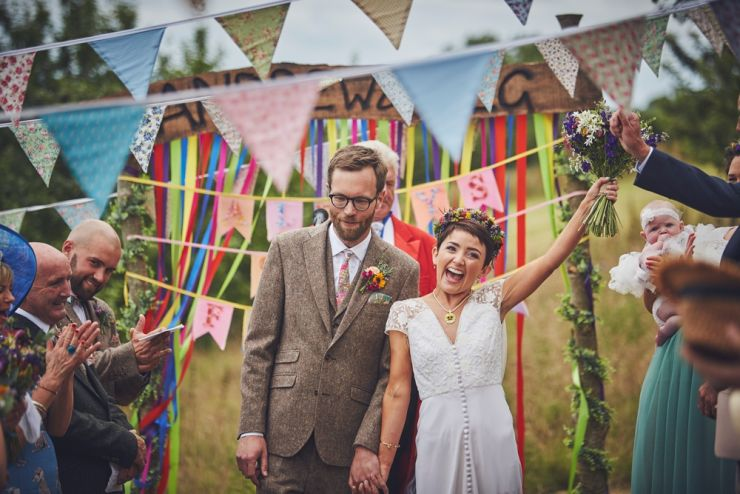 Just married happy couple at West Town Farm barn wedding photography devon