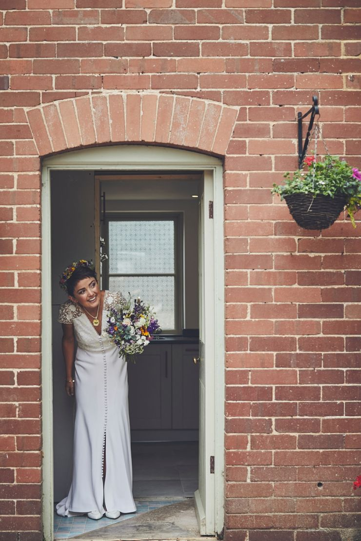 bride in doorway peering out