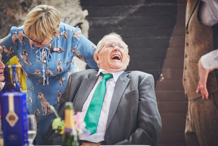 documentary wedding photography of guests laughing at a devon wedding