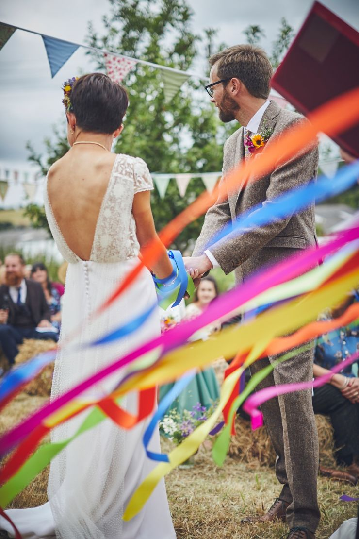 Hand tying ceremony at a wedding at West Town Farm in Exeter