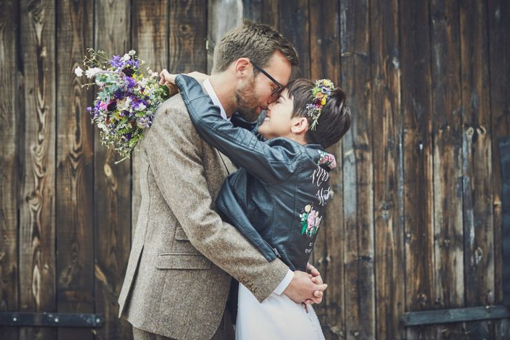 bride wearing an illustrated leather jacket and groom at a West Town Farm wedding in devon