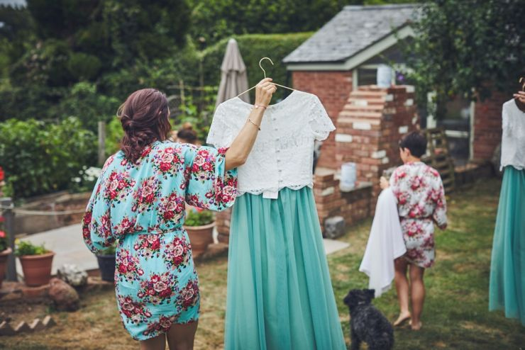 bridesmaid carrying her bridesmaids separates with a white top and green skirt