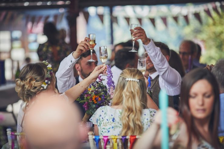 reportage wedding photography of guests at speeches at a wedding at a West Town Farm devon