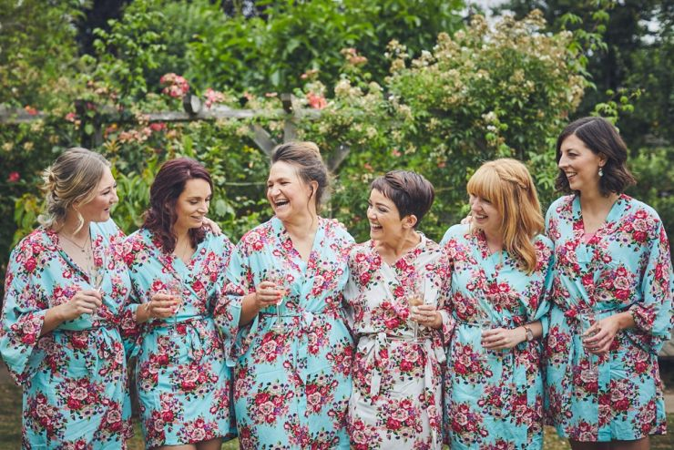 bridesmaids laughing in garden before wedding