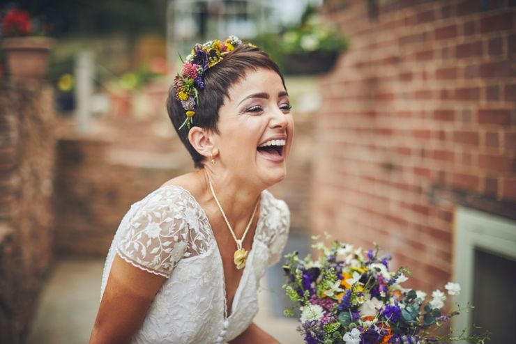 bride to be laughing wearing flower crown