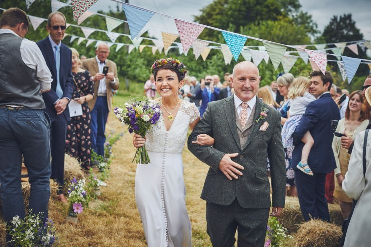 bride and dad walking down the aisle at Devon wedding