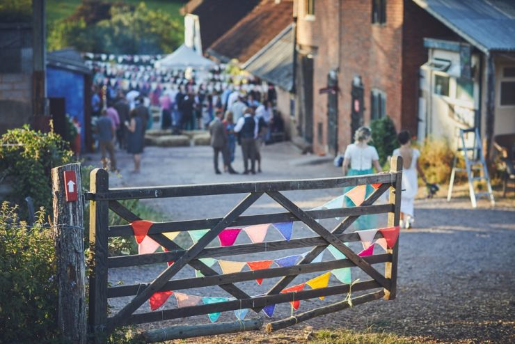 golden hour photography of wedding venue with gate and bunting at West Town Farm exeter